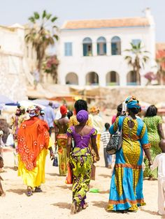 This is a richer part of Senegal. The women are going home after church, which is why they are wearing the traditional dresses