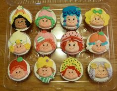 Strawberry Shortcake cupcakes by dmont1107.  Custom (and cute!) food, how many of the characters can you name?