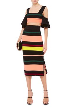 Timeless pieces with a hint of Mexico and the Southwest have long been the signature of designers Laura Cramer and Starr Hout. This **Apiece Apart** skirt features a knit construction with a pencil shape, a variegated stripe, and a scalloped hem.