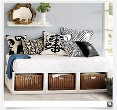 day bed with baskets- great idea for storage. Love the pillows / color pallet