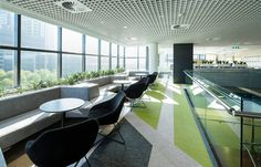Geometric floor pattern in green and grey, using Bolon woven vinyl flooring, in the office of RMS in Sydney, Australia
