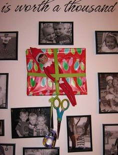 Elf on a Shelf - Antic: Wanted to wrap all the frames like presents...but wrapped himself in the process!