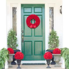 We love this monochromatic wreath combined with the bright red flowers! It makes for stunning front door: http://www.bhg.com/christmas/outdoor-decorations/front-door-christmas-decorating-ideas/?socsrc=bhgpin121413seasonalcolors&page=28