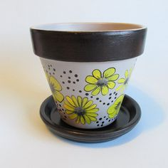 Hand-painted flower pot!  Grey, Yellow and black floral design.