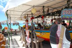 Guy's Driftwood Boat Bar, Maho Bay, St. Maarten. A bar made from a boat right on a BEAUTIFUL beach!