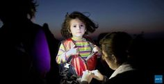 Little syrian refugee arriving in Turkey. AFP