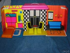 Barbie house early 1970s. I still have this house minus the furniture! LOVE it!