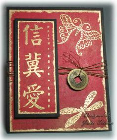 handmade greeting card by julee tilman . Asian them ... gold embossed dragonfly, butterfly and calligraphy ... red base with black mats ... coin on a multi string wrap ... lie the gold embossed around the edges of the main panels ...