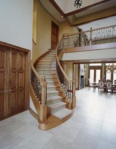 How fun would it be to have a double staircase like this? SO MUCH FUN! I would slide down the railing.