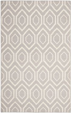 The classic geometric motifs of Safavieh's flat weave Dhurrie Collection are equally at home in casual, contemporary, and traditional settings. We use pure wool to best recreate the original texture and soft colorations of antique dhurries prized by...