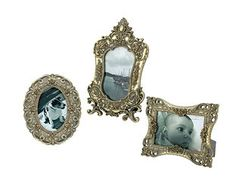 Original Gift Company Photo Frames (3) - Half Price Offer! Artfully eclectic set of 3 Baroque-style photo frames. Each with a different but equally elaborate antiqued gilded moulding. http://www.MightGet.com/february-2017-2/original-gift-company-photo-frames-3--half-price-offer!.asp