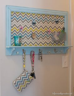 This magnetic memo board got a fab new  makeover with aqua and yellow chevron fabric.