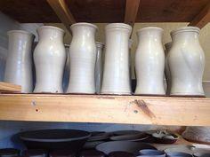 A family of freshly slipped vases #pottery #earthenware #clay #slipware #slip #slip #vase #potterystudio #wheelthrown