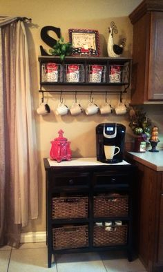 My coffee bar ! I got most of the decor and table at Hobby Lobby . I filled all the baskets with coffee, hot chocolate, to go cups, breakfast snacks, and lots of other goodies ! I think my family is going to enjoy it as much as I will. Coffee Bars In Kitchen, Coffee Bar Home, Coffee Wine, Coffee Is Life, Cafe Kitchen Decor, Kitchen Dinning Room, Coffee Nook, Coffee Corner, Remodeling Mobile Homes