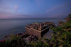 The famous Rock Bar at Ayana Resort Bali. It still the most popular place to catch sunset and tasty cocktails. Photo courtesy of Ayana Resort.