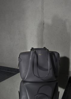 • CHARCOAL OFFICE BAG • Timeless office bag made out of Italien calf leather. Three compartments, several lining pockets and a good sense for stylish business ladies. #officebag #shopper #leather #calf #accessories #bag #handbag #timeless #charcoal #timeless #minimal #reduced #modern #contemporary #fashion #signature #trendy #raellezurich www.raellezurich.com Bag Making, Making Out, Contemporary Fashion, Calf Leather, Business Women, Bucket Bag, Calves, Charcoal, Minimal