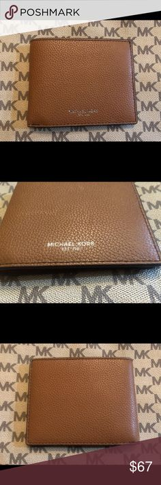 73de6b110902 MICHAEL KORS | Russel Bifold Wallet Crafted in luggage soft pebbled  leather. This billfold wallet