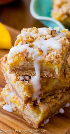 Vanilla Glazed Peaches 'n Cream Bars - a four layered bar with a brown sugar/oat crust, a creamy peach filling, pecan streusel, and vanilla glaze!