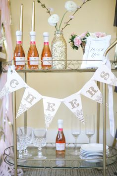 Set the tone by adding a festive banner to your bar. Kayden Ashley Designs has cute printables you can download for free!   Photo by A Girl and a Camera for Katie Rebecca Events