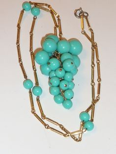 A personal favorite from my Etsy shop https://www.etsy.com/listing/116419655/vintage-mod-turquoise-grape-cluster
