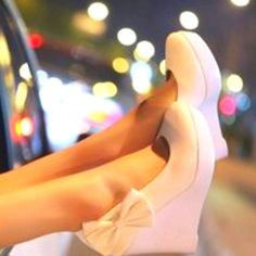 White bow wedges. Much more comfy than heels.