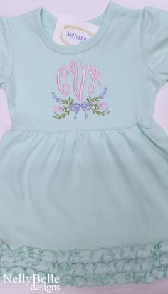 Perfect in pastels. Sweet floral monogram is embroidered on a mint green cotton knit dress. NellyBelle Designs