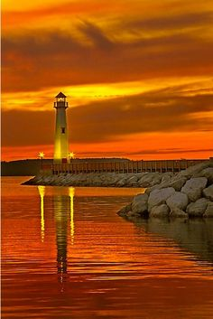 Just a fantastic photo of a light house at sunset.
