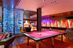 Modern basement with bowling alley & pool table..maybe add an air hockey table and some arcade games. Awesome game room. Kids & adults would love it.