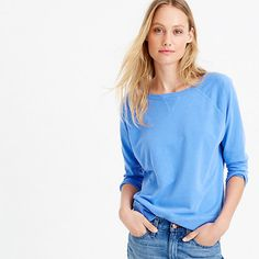 """Made in LA from garment-dyed cotton, this sweatshirt is sewn, then dyed, for a perfectly imperfect color that's a little more saturated around the seams (and will only gain more character with time). <a href='https://hello.jcrew.com/2015-02-mar/garment-dyed-tees'><u>Go behind the design.</u></a> <ul><li>Loose fit.</li><li>Body length: 23 1/2"""".</li><li>Cotton/poly.</li><li>Machine wash.</li><li>Made in the USA.</li></ul>"""