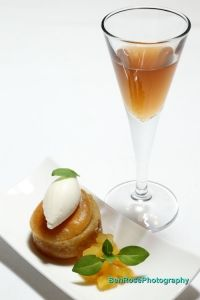 An amuse bouche dessert: pineapple Baba au Rhum with spicy Rum cocktail at Ritz-Carlton Buckhead