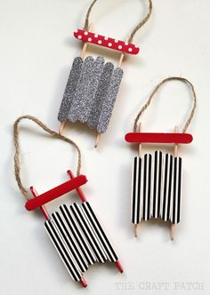 Make these cute handmade photo ornaments using popsicle sticks cut and hot glued to look like a miniature sled. A perfect ornament craft for kids.
