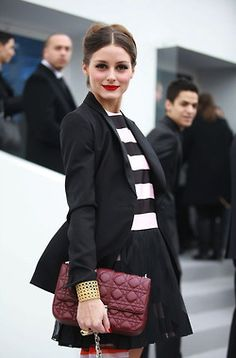 Love how she's pulled this outfit together - the pops of red/maroon hues with classic black and white
