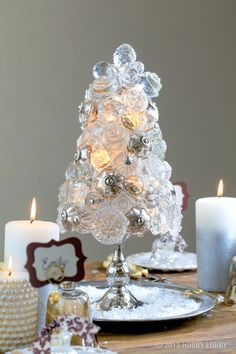 To make this knob-bedecked tree, hot glue an assortment of clear and mercury glass knobs to a StyrofoamTM cone. Then simply tuck crystal-like beads topped with filigree bead caps into any gaps to fill in this stunning centerpiece.