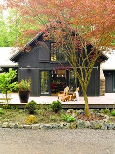 Pole Barn House Plans and Rates Exterior Farmhouse with Adirondack chairs Barn … - pole barn homes Barn House Design, Cabin Design, Loft Design, Deck Design, Landscape Design, Modern Design, Black House Exterior, Cottage Exterior, Cabin Exterior Colors