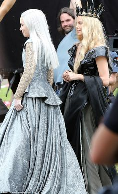 One in silver, Emily Blunt as the Ice Queen Freya and one in black, Charlize Theron as the Evil Queen Ravenna. From The Huntsman Winter's War.