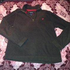 American Eagle Outfitters fleece pullover Chocolate brown with red trim. Super soft and comfy. Excellent condition. American Eagle Outfitters Tops Sweatshirts & Hoodies