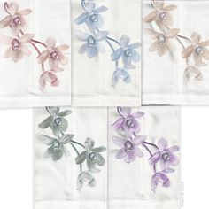 Anali's Sunset Orchid embroidered design is available in 5 colorways on white linen guest towels.