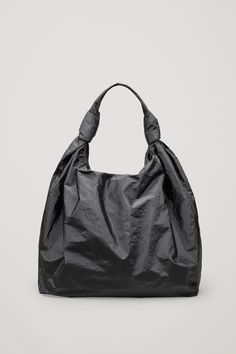 Made from a highly durable material with a papery finish and coated quality, this bag has a soft cotton lining. A shopper style designed to hang off the shoulder, it is completed with a subtle magnetic fastening. Cos Bags, Bag Illustration, Cotton Bag, Handmade Bags, Hobo Bag, Sanya, Fashion Bags, Bag Accessories, Leather Bag