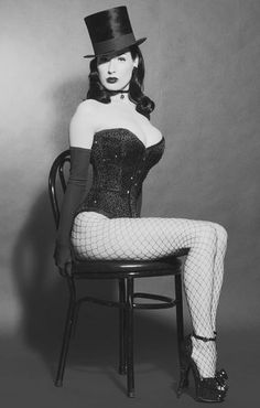 Dita Von Teese. Love the hat and fishnets. - One day I'd like to do this....