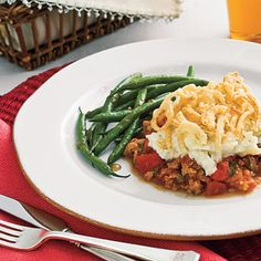 Onion-Topped Sausage 'n' Mashed Potato Casserole | You'll be impressed by how fuss-free this supper really is. This casserole is packed with a rich, meaty tomato sauce and refrigerated mashed potatoes and topped with crunchy, kid-approved fried onions.