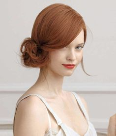 Elegant hair and makeup for red hair, ivory skin.