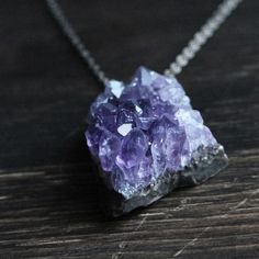 A natural dark purple amethyst geode hangs on a gunmetal chain. Combining elegance and rustic, natural style, the amethyst is a prime example of nature at its finest! Amethyst Geode, Purple Amethyst, Amethyst Pendant, Crystal Pendant, Geode Necklace, Amethyst Necklace, Geode Jewelry, Rock Necklace, Crystal Necklace