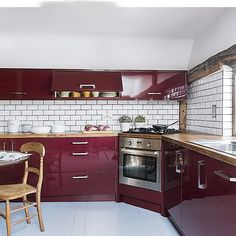 Country kitchen with burgundy cabinetry