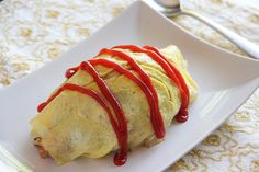 """Omurice,+omelet+rice,+is+ketchup+fried+rice+wrapped+with+a+crepe-like+thinly+fried+egg. +Doesn't+sound+like+Japanese+food,+does+it? +Omurice+is+a+""""western+style""""+dish+created+in+Japan+in+the+early+1900s. +For+over+100+years,+Omurice+has+been+a+very+popular+food+for+people+of+all+ages,+…"""