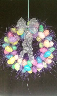 Easter wreath that I created using cardboard cut into a large ring, plastic eggs, easter grass and lots of hot glue!
