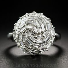 Baguette Diamond Cocktail Ring There isn't a disco ball in the world that can compete with this mesmerizing orb-on-a-ring, composed of 72 bright-white baguette diamonds, totaling 2.00 carats, set in platinum. - What's New