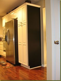 chalkboard wall on end of kitchen cabinets