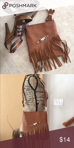 Nwot brown fringe purse Brown fringe purse. Medium sized. Great for going out. Never used Bags Crossbody Bags