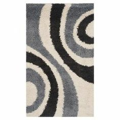 """Anchor the living room or define a space in your master suite with this artfully loomed shag rug, showcasing a swirling motif for eye-catching appeal.    Product: RugConstruction Material: PolypropyleneColor: Ivory, black and greyFeatures:  Power-loomedShag pile          Pile Height: 0.5""""Note: Please be aware that actual colors may vary from those shown on your screen. Accent rugs may also not show the entire pattern that the corresponding area rugs have.Cleaning and Care: Professional ..."""
