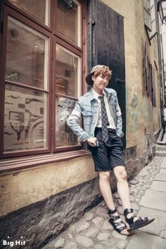 "[BTS in Sweden: Mischievous boys in Europe] - J-HOPE Date: July 30th 2014 Location: Gamla Stan, Stockholm ""Those became magazine photos thanks to the beautiful streets although we took them roughly. Whenever sitting on the steps, leaning against the wall, and just walking on the street, they made pictorial photos! Because of the sudden rain during the shooting, they got embarrassed but soon posed naturally with umbrella."""